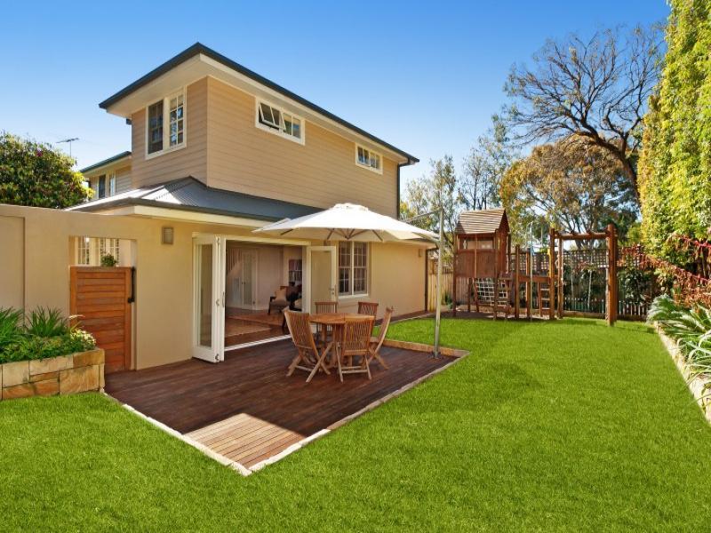 Landscaped garden design using grass with deck hedging for Garden ideas with decking and grass