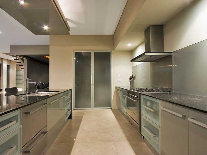 Modern galley kitchen design using frosted glass kitchen for Galley kitchen designs