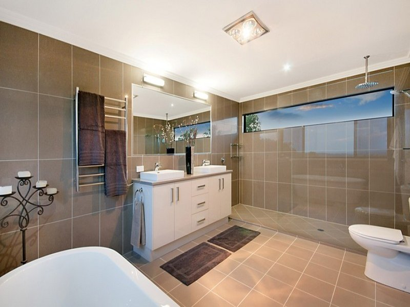 Modern bathroom design with claw foot bath using frameless for Australian bathroom design ideas