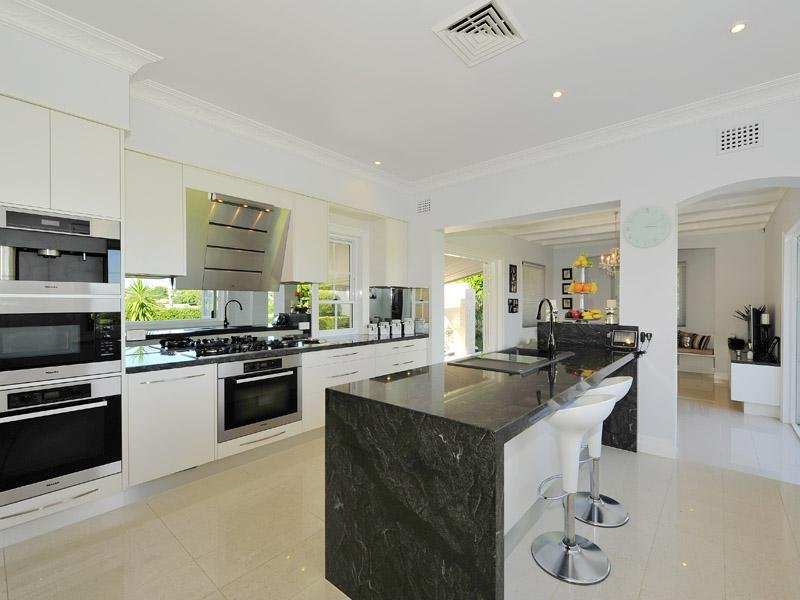 Modern island kitchen design using granite Kitchen