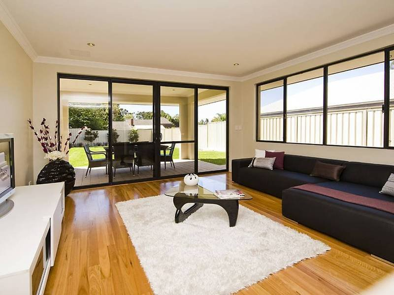 Split Level Living Room Using Cream Colours With Carpet
