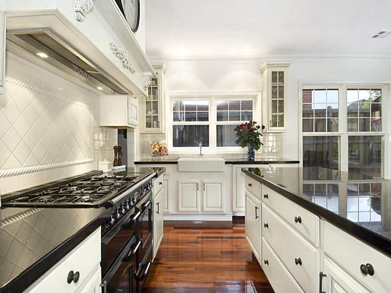 Classic galley kitchen design using floorboards kitchen for Great galley kitchen designs