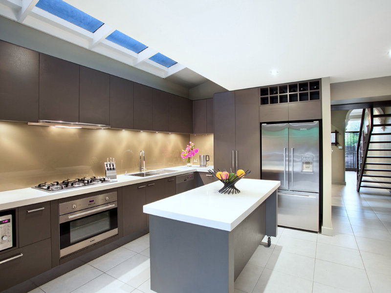 modern galley kitchen design using stainless steel