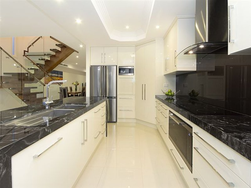 Modern galley kitchen design using marble kitchen photo for Modern galley kitchen ideas