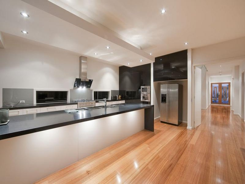 Art deco island kitchen design using granite kitchen for Galley kitchen designs australia