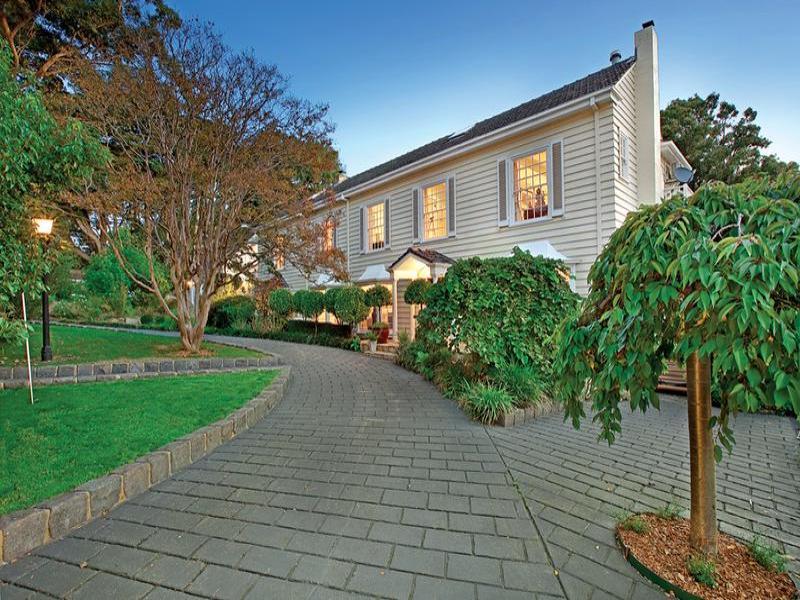 landscaped garden design using brick with orchard  u0026 decorative lighting