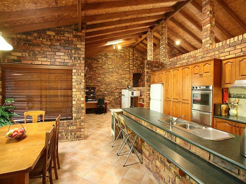 Country galley kitchen design using exposed brick for Country galley kitchen designs