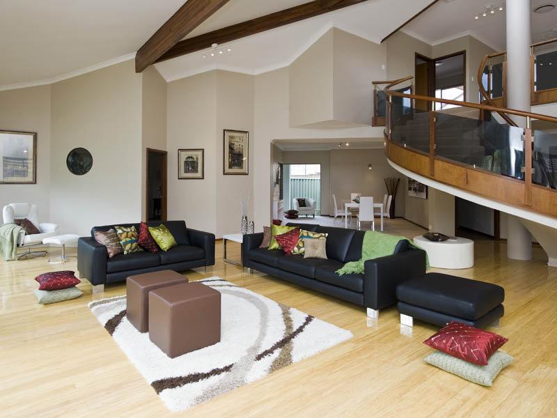 Split level living room using black colours with hardwood for Split living room ideas