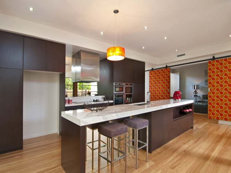 Modern island kitchen design using floorboards kitchen for Modern kitchen designs with island