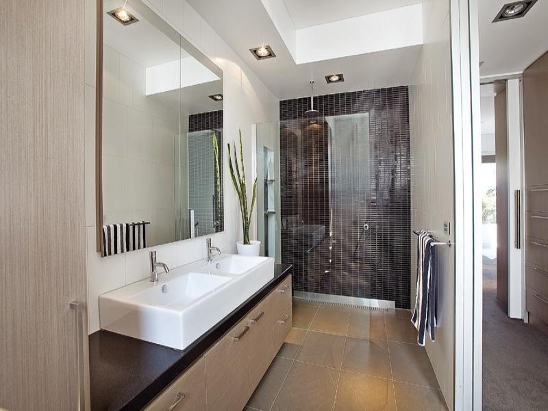 Modern bathroom design with twin basins using ceramic for Tiny ensuite designs