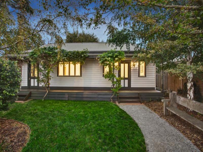 low maintenance garden design using grass with retaining wall  u0026 outdoor furniture setting
