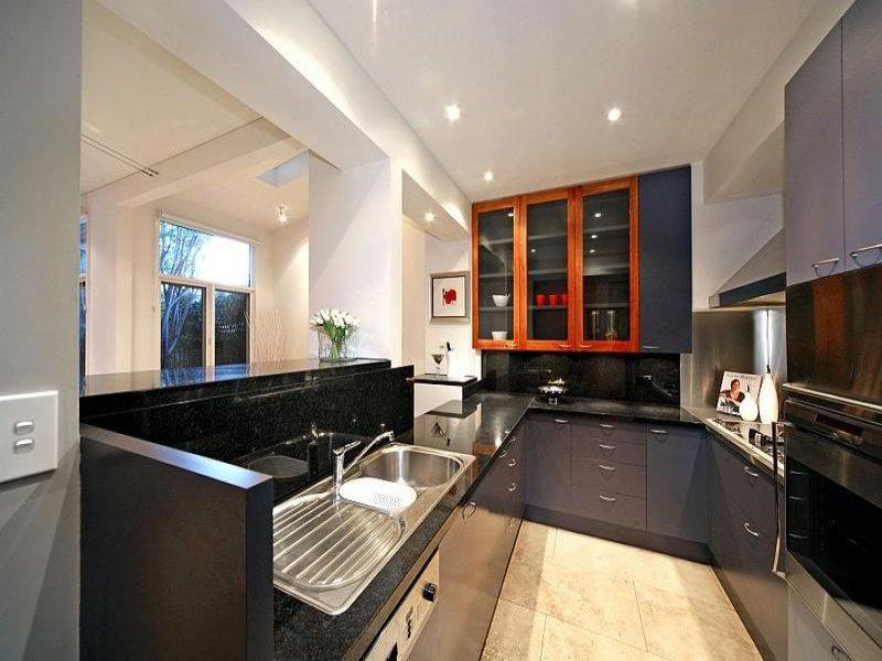 modern u shaped kitchen design using marble kitchen photo 1321698. Black Bedroom Furniture Sets. Home Design Ideas