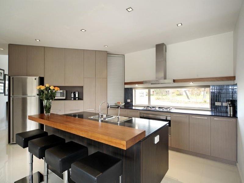 modern island kitchen design using granite kitchen photo 1413199