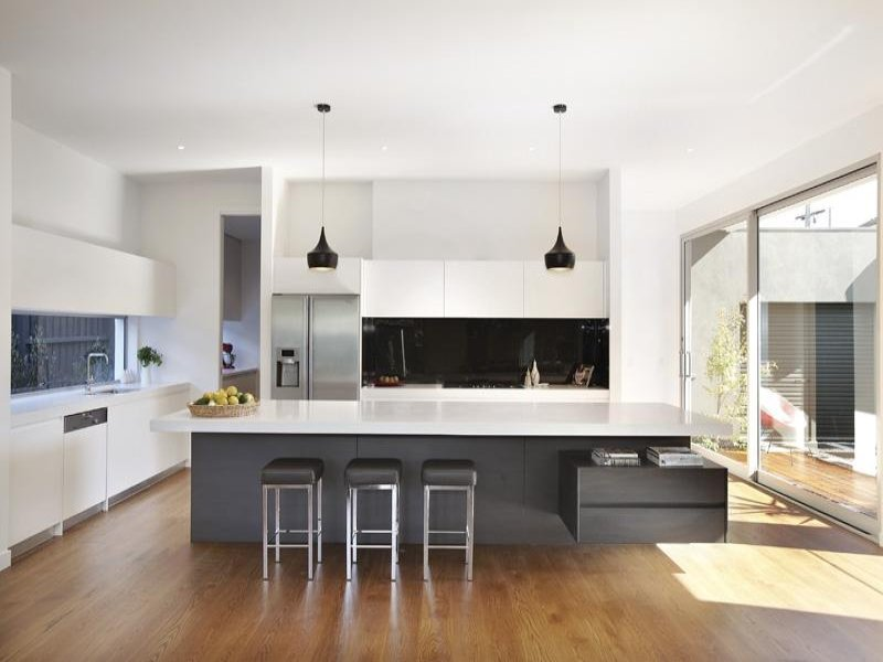Modern island kitchen design using floorboards kitchen for Modern kitchen design australia