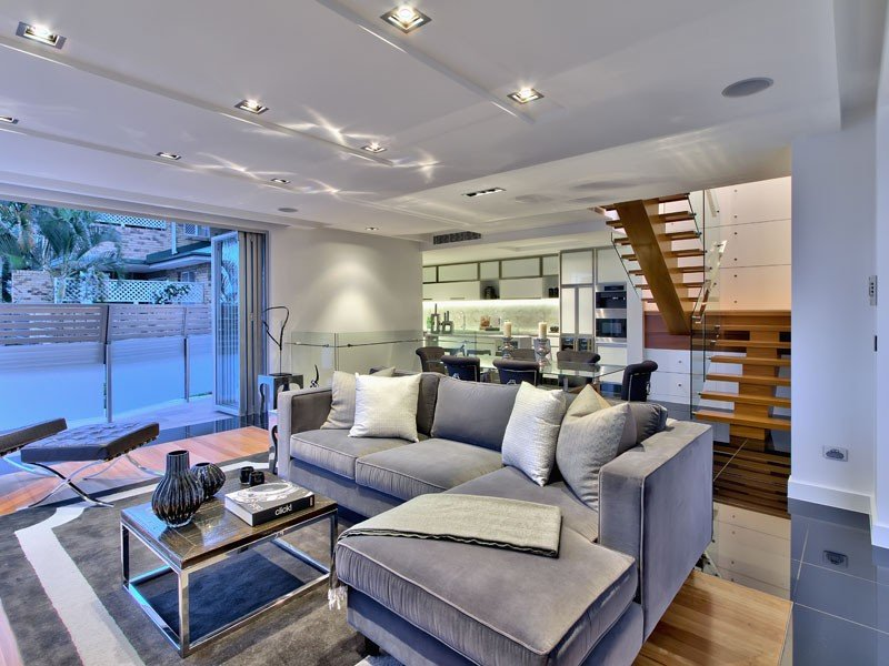 Open plan living room using grey colours with floorboards & bi-fold doors - Living Area photo ...