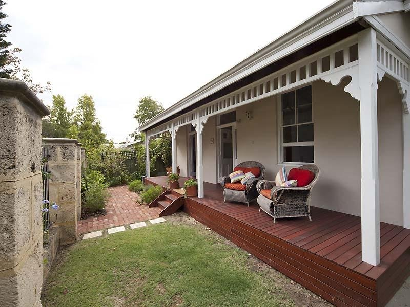 landscaped garden design using brick with deck  u0026 outdoor furniture setting
