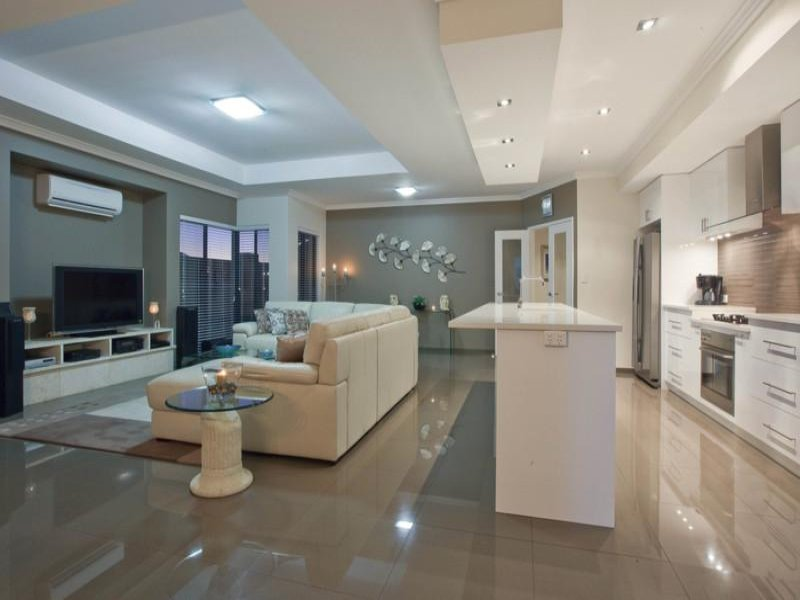 Modern island kitchen design using polished concrete for Kitchen designs modern homes