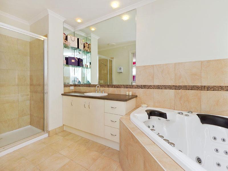 Modern bathroom design with corner bath using ceramic for Modern spa bathroom ideas