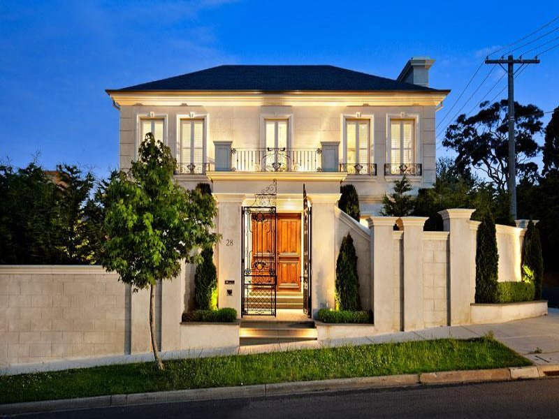 Photo of a rendered brick house exterior from real for Classic home designs australia