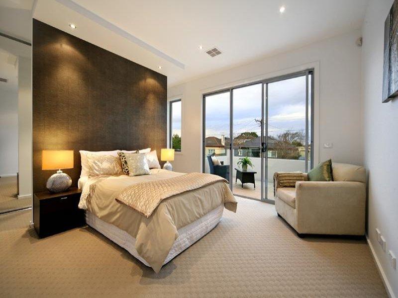 Modern bedroom design idea with carpet & bi-fold windows ...
