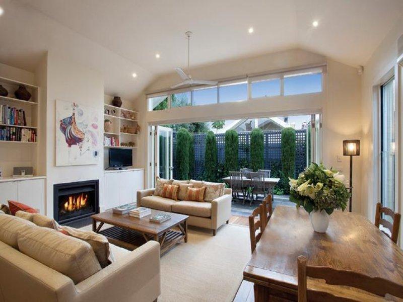 bathroom ideas attic lighting - Dining living living room using beige colours with carpet