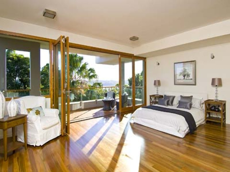 8 foot ceiling design ideas - Modern bedroom design idea with floorboards & balcony